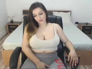 natashaboobs sexy camgirl poses nude by a wall